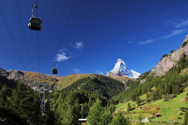 Taking the cable car to the mountains.