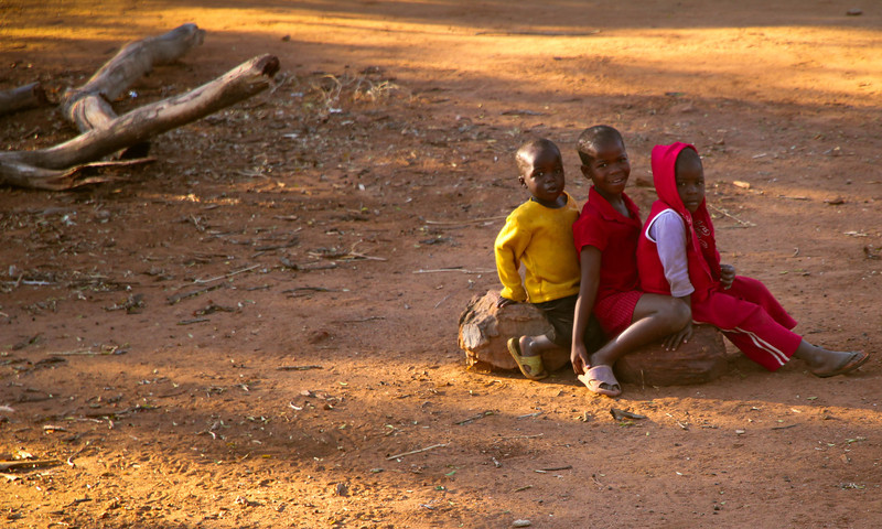 These kids were just hanging out squeezing themselves on a log of wood. Perfect!