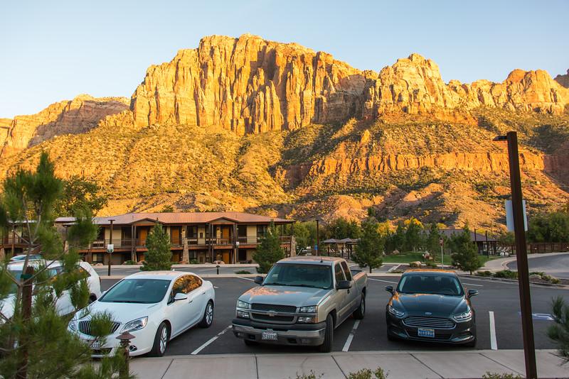 My rental (white Buick Verano) parked with nice back drop at the La Quinta Inn - Springdale, UT - November 2014