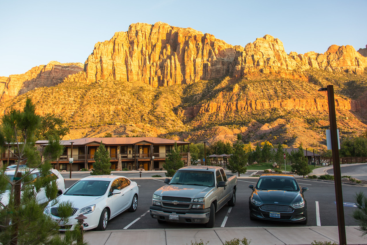 My rental (white Buick Verano) parked with nice back drop at the La Quinta Inn - Springdale, UT - November 2014