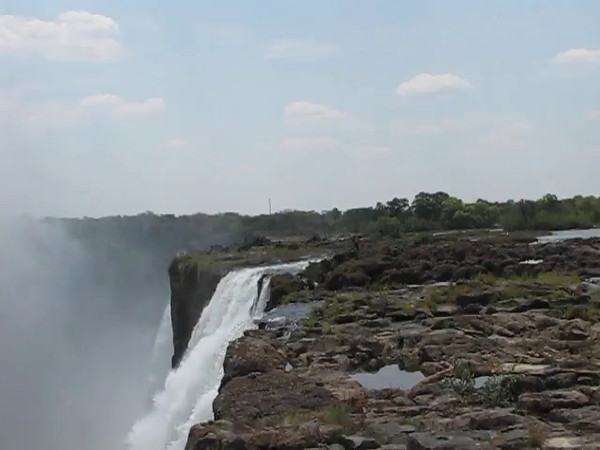 The main channel at Victoria Falls, with swimmers in Devil's Pool. We later made our way out to the rocks in the middle of this video where we swam in Devil's Pool, right on the edge of the waterfall.