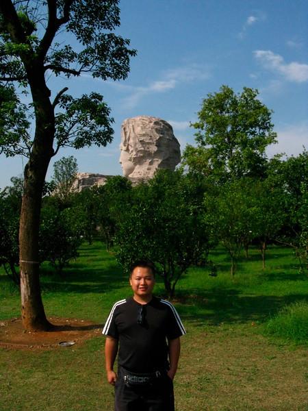 Mike (translator) behind young Mao Zedong
