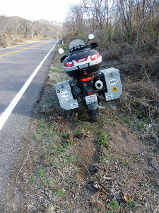 Roadside stop. Note the hole- I got the bike highcentered and stuck. This is after I got unstuck.
