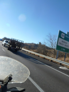 Note kilometer sign. Also, the truck with trailer is carrying quads- it's a US Border Patrol vehicle.