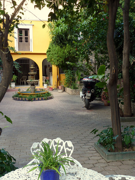 Hotel Juanita's in Creel with my motorcycle parked in the courtyard.