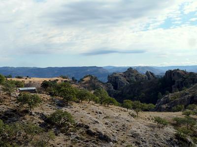 House and mesas/canyon walls.