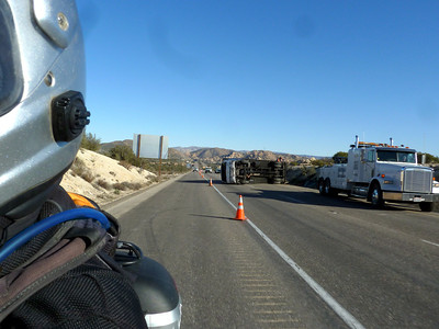 Overturned truck. Oh bother. Wind or sudden steering input? Either way, bad day for one truck driver.