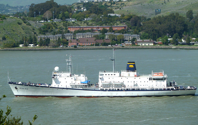 The California Maritime Academy's GOLDEN BEAR cruises through the Carquinez Strait, right in front of the university campus itself.