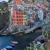 Colorful houses and boats in Riomaggiore, Cinque Terre, Italy