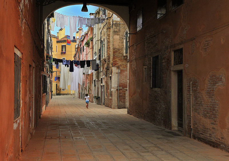 Boy Running Under Laundry in Castello District of Venice, Italy