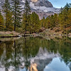 The Matterhorn (Cervinia) at sunset reflected in Lake Blue, just outside the village of Cervinia in Valtournenche, Italy