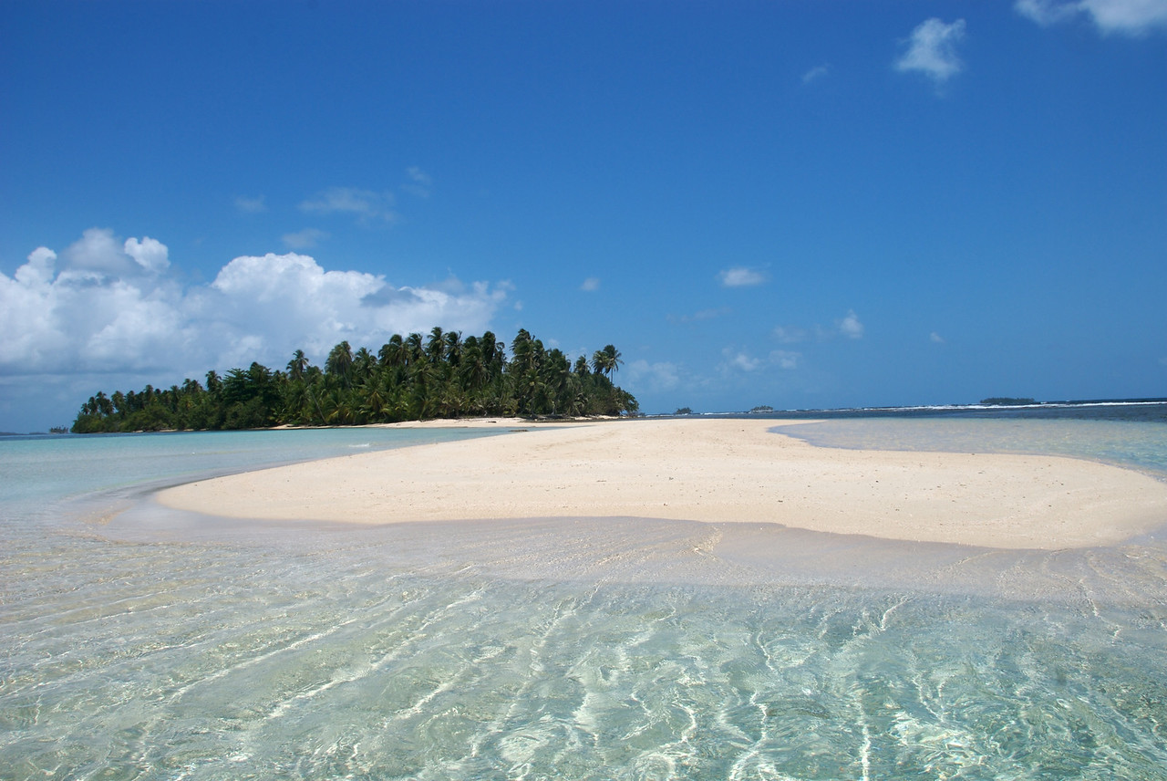 a pristine deserted tropical island in the San Blas islands of Panama