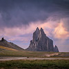 Storm clouds at sunset over Shiprock volcanic rock formation near Shiprock, New Mexico
