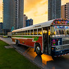 Panama City, Panama - March 18, 2014: Red Devil Bus (Diablo Rojo) in a street of Panama City at sunset. Red Devil buses are public transports painted in bright colors and symbols.