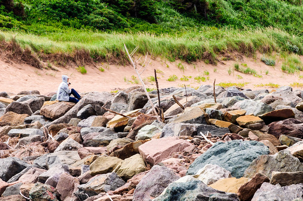 Sitting on a rocky shoreline