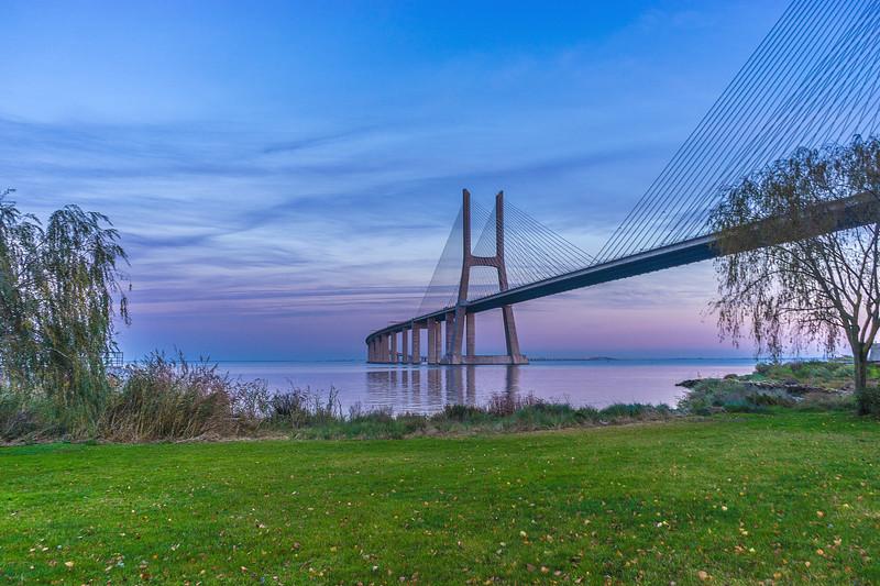 Vasco da Gama Bridge at Sunset Photography By Messagez com