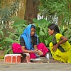 Two women in Rajasthan cooking in an open hearth
