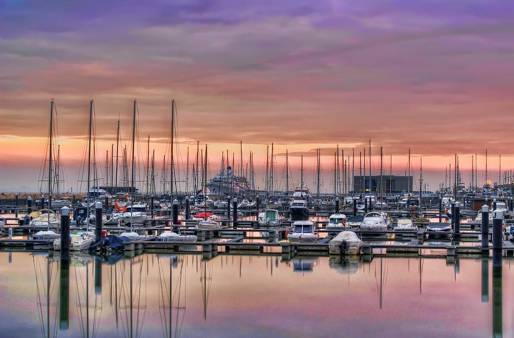 Marina boats photo in lisbon at sunset