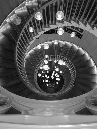 A surprise discovered in Heals furniture store, Tottenham Court Road,  The building features a stunning spiral staircase also known as the Brewer Staircase, The hypnotic whirl spins up to the fourth floor and takes customers to the Mansard Gallery.  The stairs were designed by architecture Cecil Brewer in 1916.