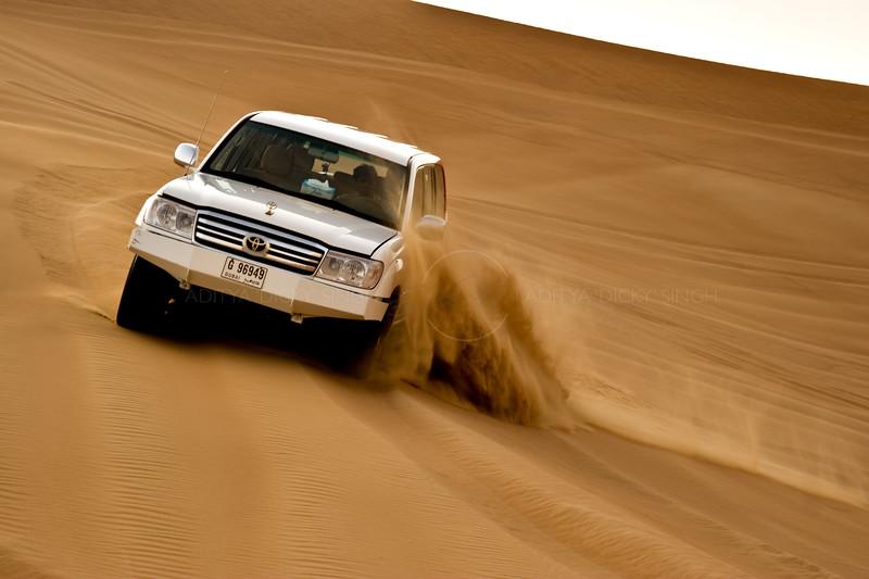 SUV racing in the sand dunes of Dubai