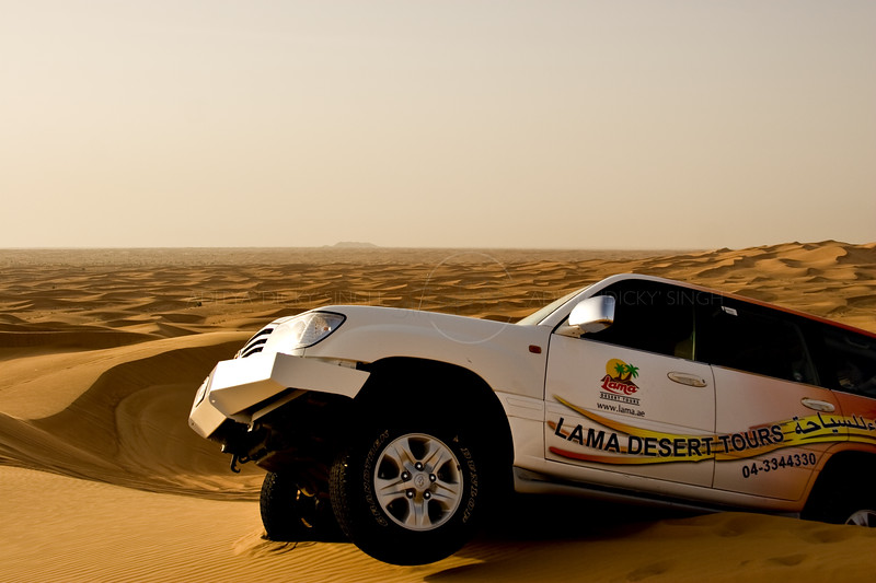 SUV stranded in the sand dunes of Dubai