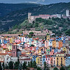 Colorful houses in the old village known as Sa Costa adorn the hillside below the medieval castle, Castello di Serravalle in the town of Bosa, founded in 1112 along the Temo River on the west coast of Sardinia, Italy