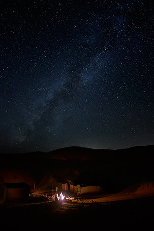 The Milky Way over the Erb Chebbi dunes, near Merzouga, Morocco.  Our camp in the foreground.