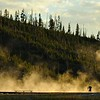 Photographer at sunset in the Yellowstone national park during summers