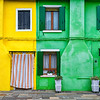 Colorful houses with rustic windows and shutters on the island of Burano, Italy