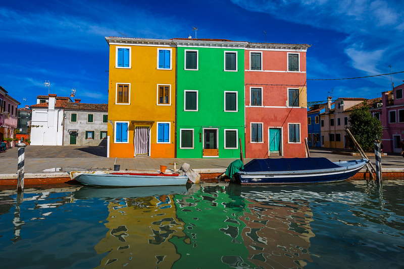 Houses and reflections in canal, Burano, Italy