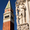 Adam and Eve Sculpture on the Doge's Palace with San Marco Campanile (St Mark's Campanile), bell tower of St. Mark's Basilica, Piazza San Marco, Venice, Italy