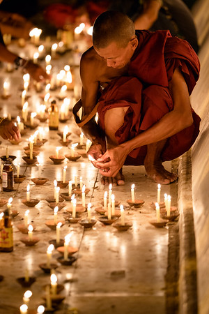 A monk lights candles at a temple in Bagan, Myanmar.