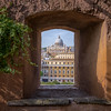 St. Peter's Basilica seen through an archway at Castel Sant'Angelo, Rome, Italy
