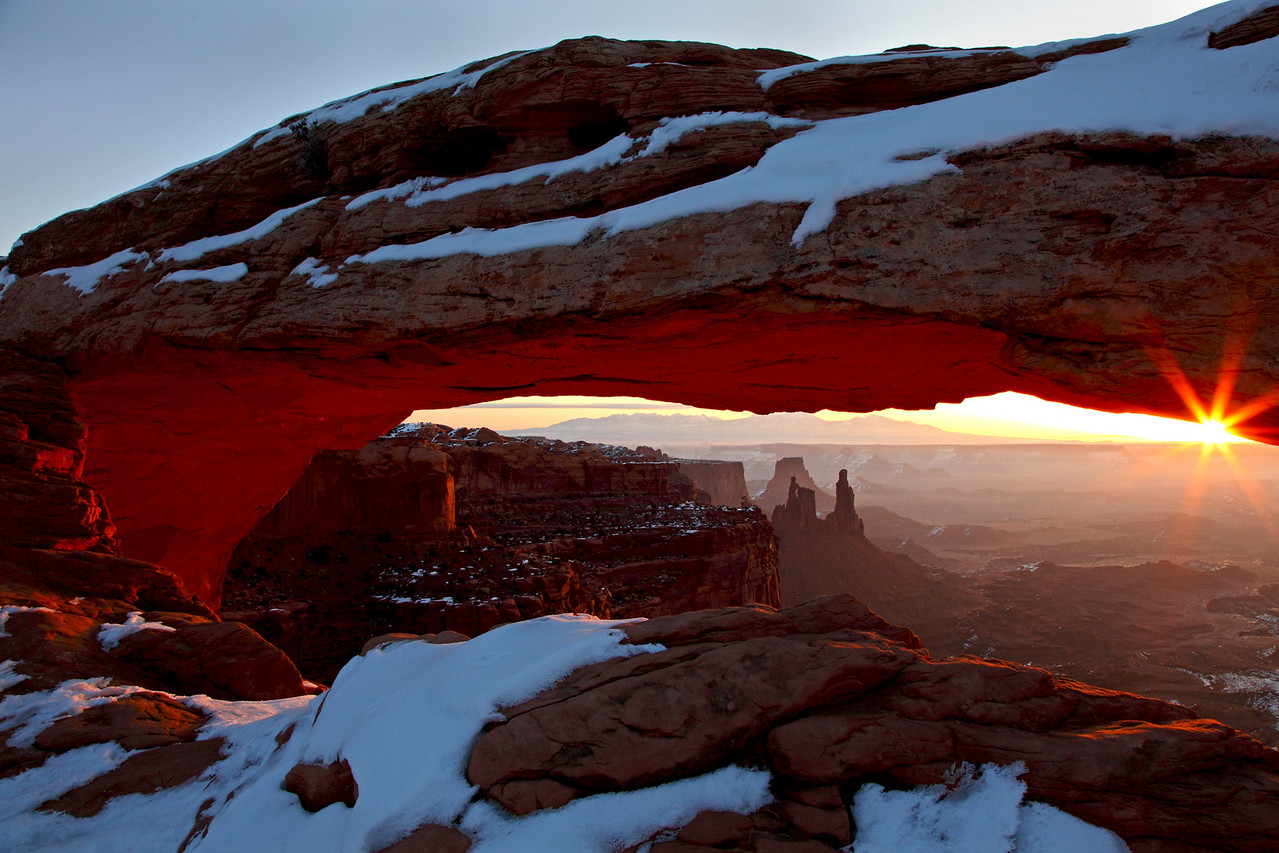 Mesa Arch at sunrise on a cold winter morning in Canyonlands National Park, Utah