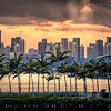 Sunset with crepuscular rays over downtown Miami as seen from Miami Beach, Florida