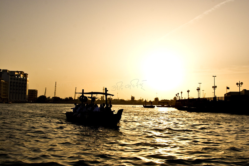 Boat on Dubai creek at sunset