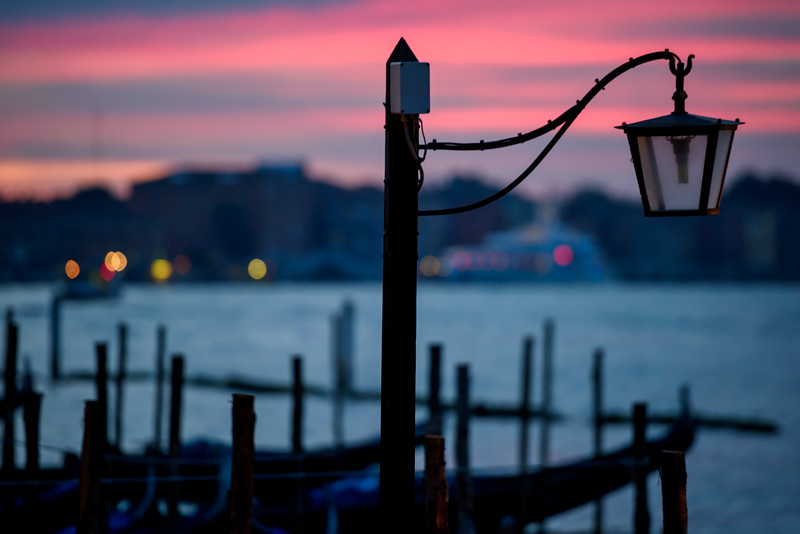 View of lantern and gondola station at sunrise in Venice, Italy