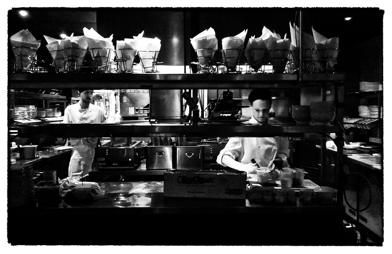 Cooks prepare food at a late night restaurant in downtown Toronto