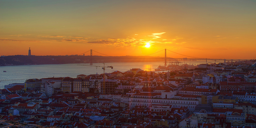 Image of the sun shining in lisbon over tagus river