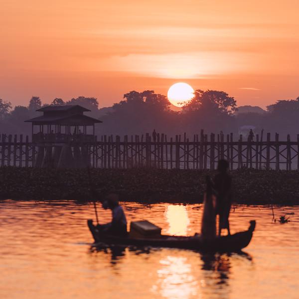 Sunset behind U Bein Bridge in Myanmar.