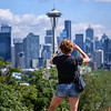 Tourist taking a photo of the Seattle Space Needle at Kerry Park, Seattle, Washington State