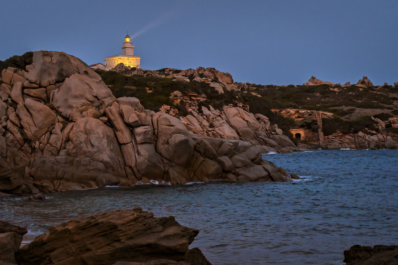 Pre-dawn light beam at Capo Testa Lighthouse, an active lighthouse located at the northernmost point of Sardinia on the western entrance to the Strait of Bonifacio