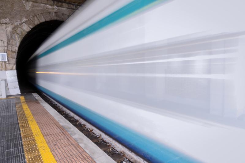 Trenitalia train going into the tunnel at the Manarola train station, Cinque Terre, Italy