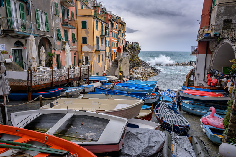 Boats taken out of the marina in preparation for a storm, Riomaggiore, Cinque Terre, Italy
