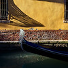 Afternoon shadows along a canal with gondolo, Venice, Italy