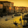 Boats, gondolas and vaparettos on the Grand Canal at sunset near the Rialto Bridge, Venice, Italy