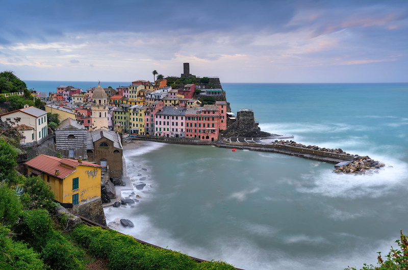 The Santa Margherita di Antiochia Church, the medieval Doria Castle and marina just after sunrise in Vernazza, Cinque Terre, Ligurian coast, Italy