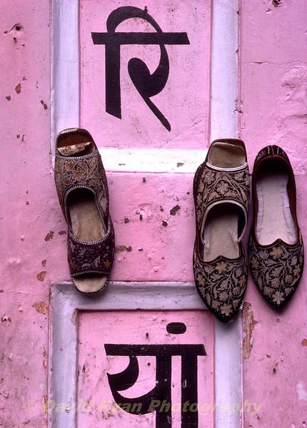 India, Rajastan, Jaipur, Rajastani Shoes on the floor of a balcony