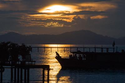 Sunset over docks at Mabul