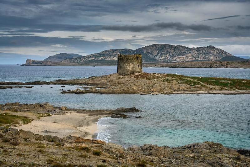 Medieval tower remains at Spiaggia della Pelosetta Beach near Stintino, Sardinia, Italy